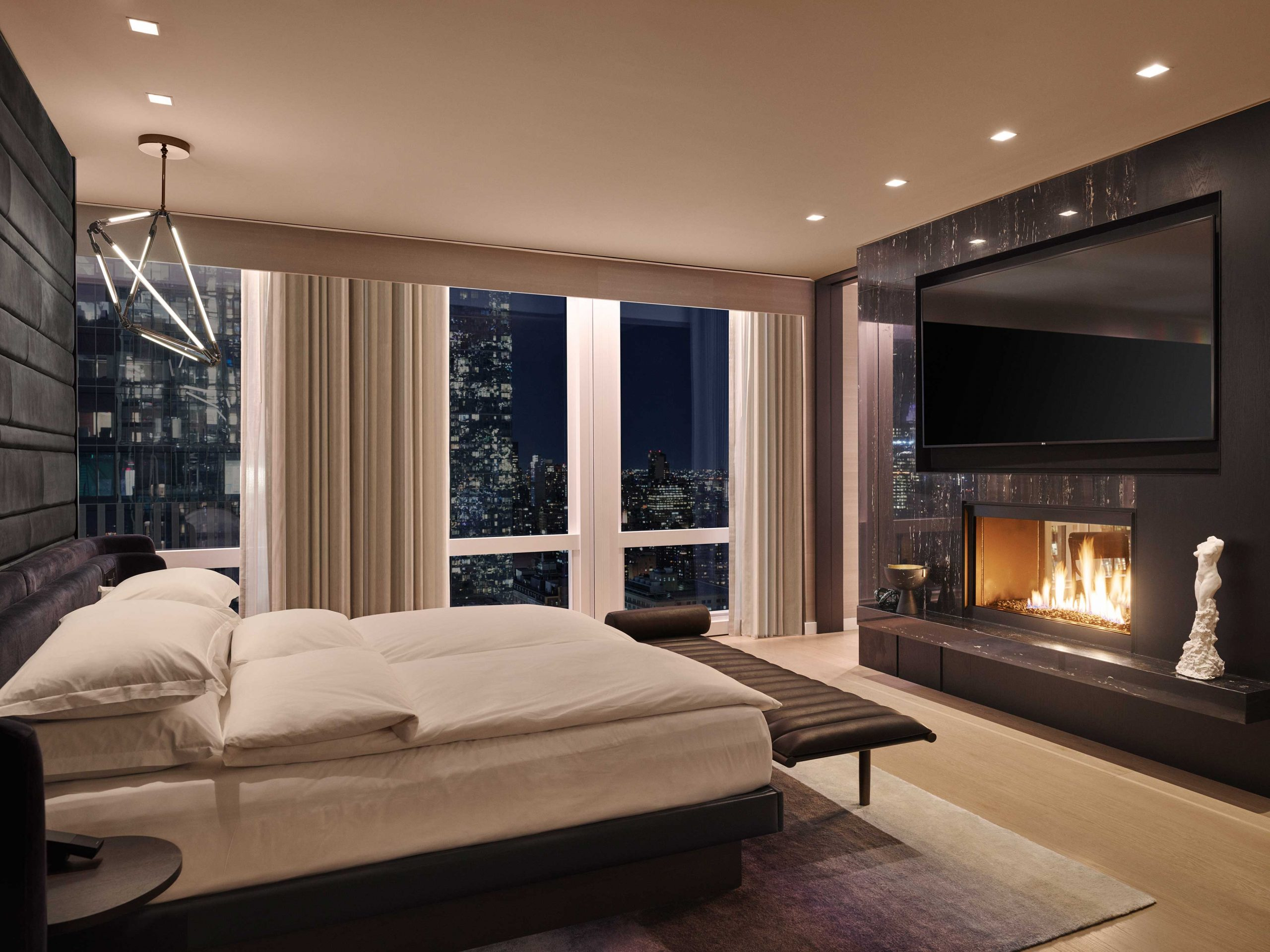 equinoxsuite-bedroom-fireplace-scaled